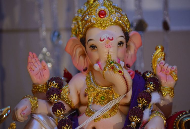 Ganpati Bappa Morya 🙏🏼 Indoors  Human Representation Multi Colored Close-up Art And Craft Still Life Selective Focus Religion Figurine  Retail  Man Made Object In A Row Person Creativity Medium Group Of Objects Arrangement Idol Focus On Foreground