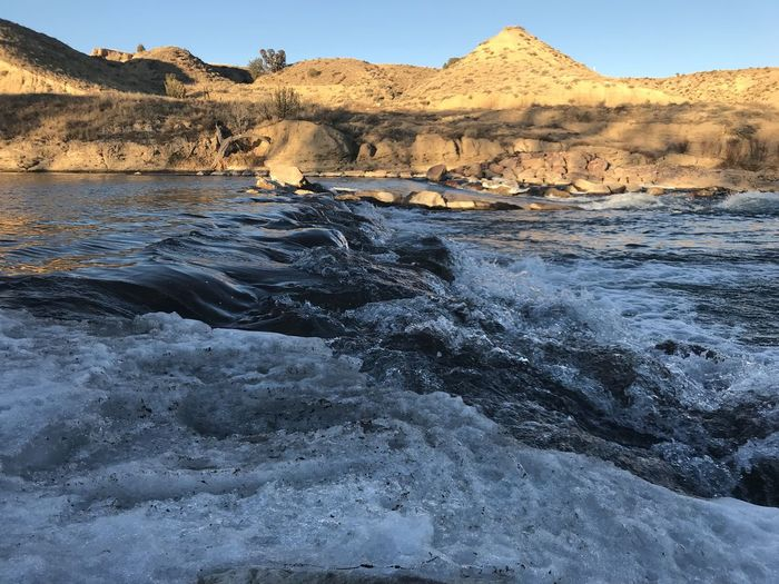 Arkansas River near Florence, CO Beauty In Nature Day Geology Landscape Mountain Nature No People Outdoors Physical Geography Rapids River Rock - Object Rock Formation Scenics Sky Tranquil Scene Tranquility Water