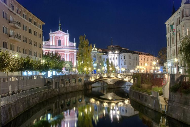 Reflection of illuminated buildings in canal at night