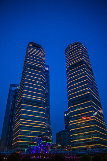 Two Buildings Architecture Blue Building Building Exterior Built Structure City Clear Sky Financial District  Illuminated Low Angle View Modern Nature Night No People Office Building Exterior Outdoors Sky Skyscraper Tall - High Tower Travel Destinations