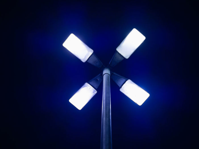 Blue Lighting Equipment Illuminated Night No People Electricity  White Color Technology Single Object Dark Electric Light Close-up Simplicity Electric Lamp Light Outdoors Light Street Light Street Lamp Symmetry Cross