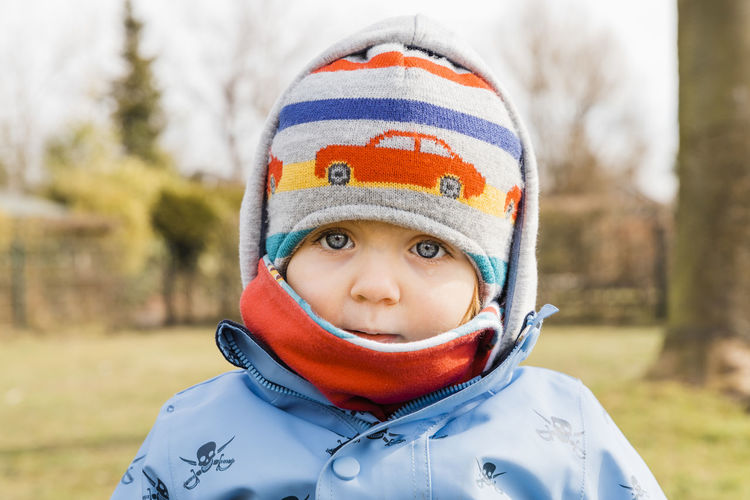 Close-Up Portrait Of Toddler Girl Wearing Warm Clothing During Winter