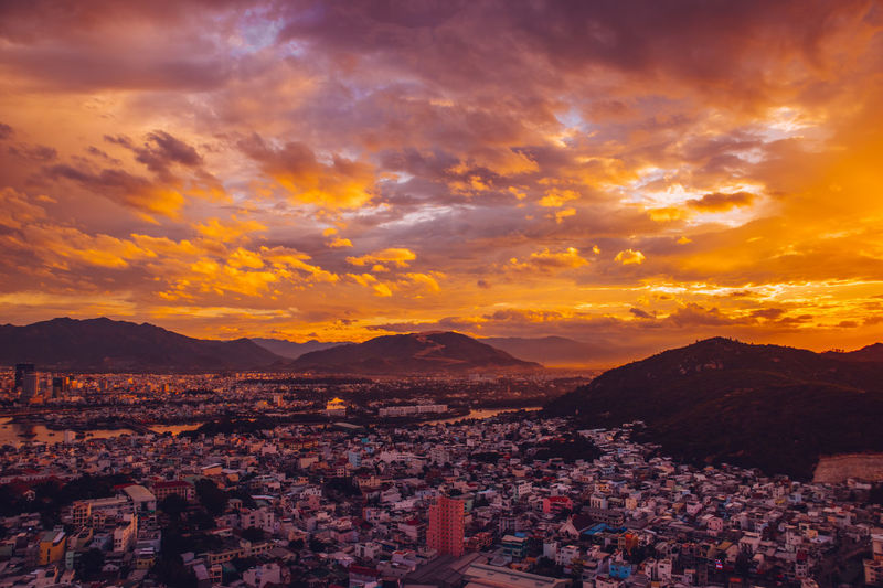Nha Trang cityview on sunset Architecture Beauty In Nature Building Building Exterior Built Structure City Cityscape Cloud - Sky Crowd Crowded High Angle View Mountain Nature Orange Color Outdoors Residential District Scenics - Nature Sky Sunset Town TOWNSCAPE