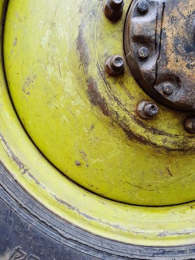 Closeup of a big wheel Close-up BIG Yellow Textured  Metal Machinery Rusty