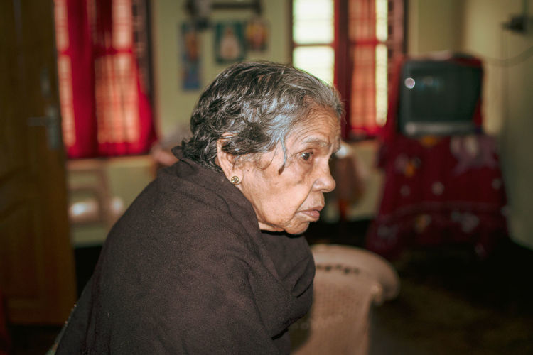 Side View Of Senior Woman At Home