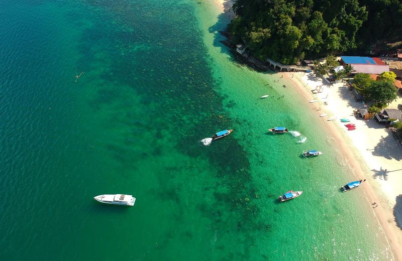 Aerial View Beach Beauty In Nature Day Green Color Group Of People High Angle View Land Mode Of Transportation Nature Nautical Vessel Outdoors Plant Scenics - Nature Sea Transportation Tree Turquoise Colored Water