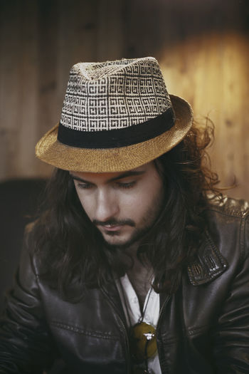 Long haired guy portrait Coffee Fashion Hat Poland Spanish Beard Beauty Black Hair Brown Hair Casual Clothing Face Guy Handsome Italian Latino Leather Jacket Lifestyles Long Hair Men Model Musician Portrait Style Sunglasses Watch