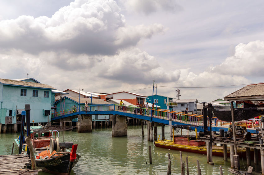 PULAU KETAM, MALAYSIA - 6th AUG 2018; A view of a fishermen's village on stilts besides the sea in Pulau Ketam (Crab Island). This island is famous for sea food products and restaurants. Malaysia Truly Asia Architecture Building Building Exterior Built Structure Cloud - Sky Crab Island Day Fishing Boat House Mode Of Transportation Moored Nature Nautical Vessel No People Outdoors Pier Pulau Ketam Malaysia Residential District Rural Scene Sky Transportation Water Waterfront Wooden Post