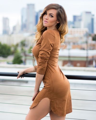 Angel in a brown dress. Model Fashion Dallas