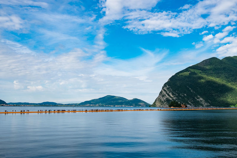 Scenic view of lake iseo against blue sky