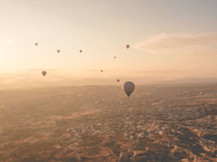 Hot air balloon in Goreme, Turkey. Adventure Aerial View Air Vehicle Balloon Ballooning Festival Beauty In Nature Day Flying Hot Air Balloon Hovering Landscape Mid-air Miles Away Nature No People Outdoors Rural Scene Sky Transportation Travel Travel Destinations Go Higher