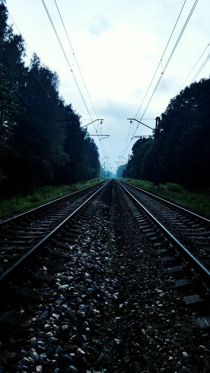 railroad track, transportation, rail transportation, cable, diminishing perspective, the way forward, sky, no people, power line, electricity, day, power supply, nature, connection, railroad tie, tree, railway track, outdoors, electricity pylon, parallel, straight, railway signal, beauty in nature