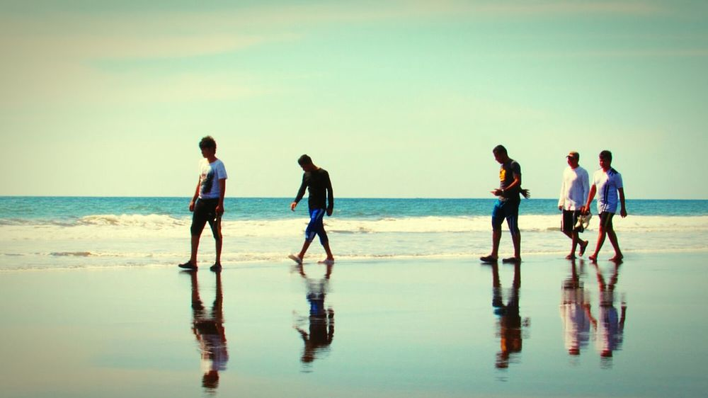 Sea Beach Togetherness Sky Reflection Outdoors Friendship People Rear View Nature Day Adult Teamwork Wave Cooperation Beauty In Nature Water Adults Only