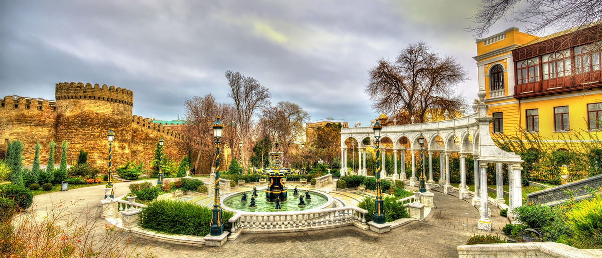 Panoramic view of park and buildings against sky