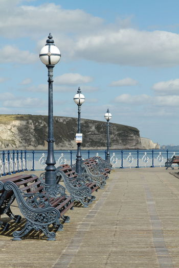 Vistorian New Swanage Pier Vistorian Pier Architecture Beach Built Structure Chair Cloud - Sky Day Electric Lamp Land Lighting Equipment Nature No People Old Pier Outdoors Promenade Railing Sea Seat Sky Street Street Light Travel Destinations Vistorian Water