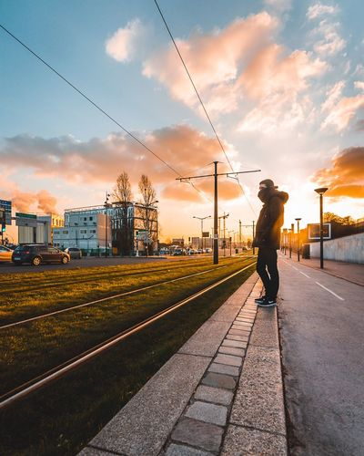 The bro +1🎉 Clouds And Sky Cloud Nikonphotography Nikon Sunset_collection Sky Cloud - Sky Transportation Railroad Track Full Length Sunset Cable One Person Rail Transportation Men Outdoors Day Architecture