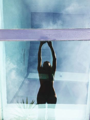 The Plunge Real People One Person Lifestyles Rear View Leisure Activity Reflection Women Day Indoors  Young Adult Young Women Sky People Experimental Window