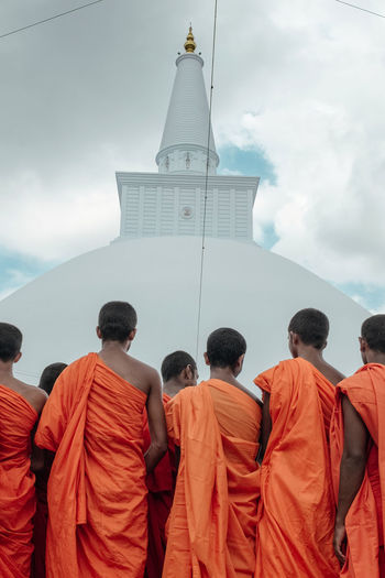 ASIA Ancient Anuradhapura Buddha Orange Pagoda Ruwanwelisaya Sri Lanka Stupa Travel Buddhism Buddhist Temple Monks In Temple Monument People Place Of Worship Praying Relics Religion Sacred Spirituality Temple