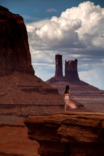 Woman standing on rock formation