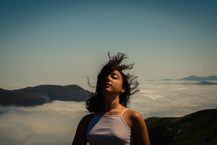 Portrait of girl against mountains against sky