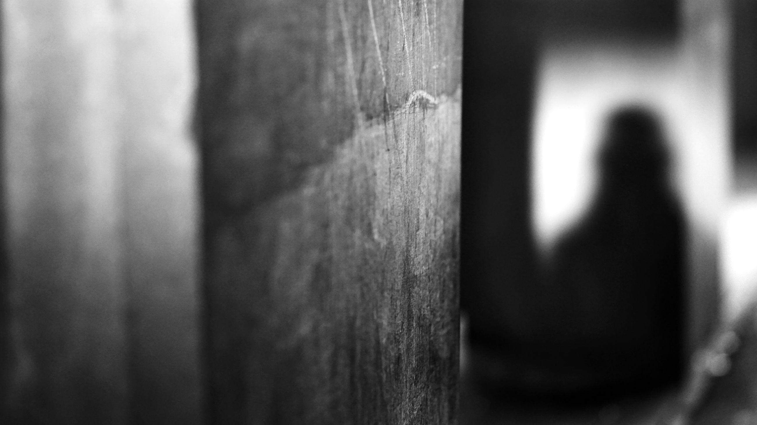 wood - material, selective focus, day, people, outdoors, real people, lifestyles, adult, architecture, built structure, close-up, men, women, wall, waist up, door, social issues, standing, focus on foreground
