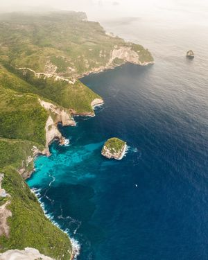 NusaPanida, Indonesia Water Sea Scenics - Nature Beauty In Nature Tranquil Scene Tranquility High Angle View Land Aerial View Nature Beach Idyllic Day Coastline Rock Rock - Object Solid Blue Outdoors No People