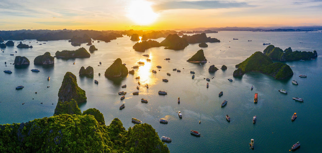 Aerial view of boats in sea during sunset