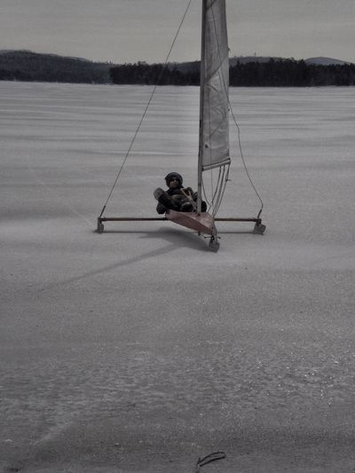Outdoors Day Real People One Person Winter Water Frozen Ice Mollasses Pond Eastbrook, ME Full Length Camp Life Leisure Activity Ice Boat Nautical Vessel Man Horizon Over Water Sailboat One Adult Man Nature People Bundled Up Scenery Beauty In Nature Sport Snow Sports