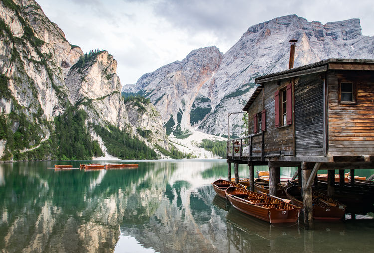 Lago Di Braies Dolomites, Italy Water Mountain Nautical Vessel Sky Architecture Building Exterior Mountain Range Lakeshore Lakeside Lake Houseboat