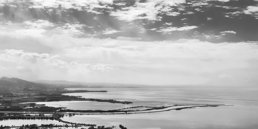 in the haze Aerial Aerial View Coastal Feature View Into Land Landscape Horizon Over Water Sky Summer Mountain Beach Water Lake Of Constance Bodensee EyeEm Nature Lover Dramatic Lighting Majestic Natural Landmark Mountain View Alpine Landscape Alps Alpen Dramatic Landscape Monochrome Blackandwhite Betterlandscapes Scenics Beauty In Nature Cloud - Sky Clouds Lake Paysages Grys