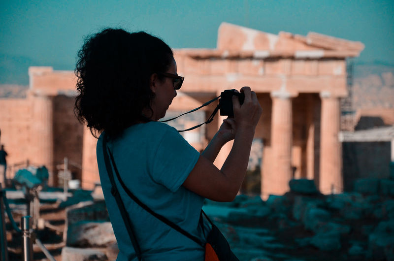 Side view of woman photographing