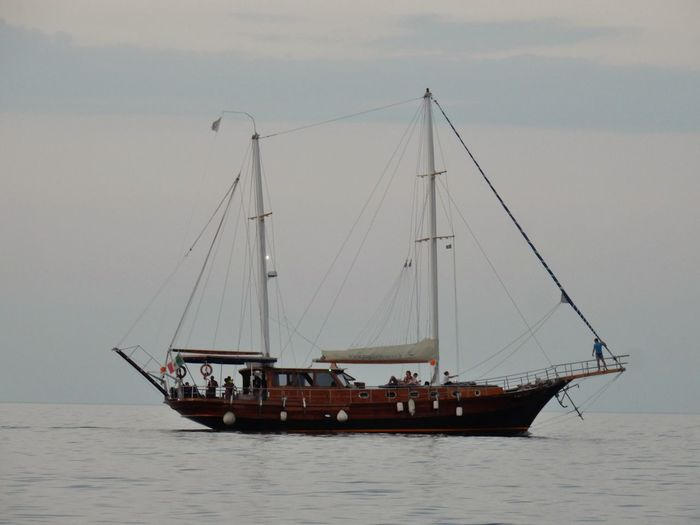 Transportation Nautical Vessel Water Mode Of Transportation Sea Sky Sailboat Mast Nature Sailing Waterfront Pole Travel Ship Day Group Of People Outdoors Sailing Ship Horizon Fishing Industry Caicco Nave Tramonto Adriatic Sea Turisti