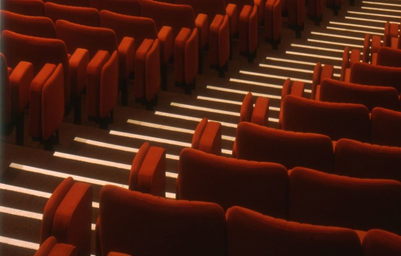 High angle view of empty chairs in movie theater