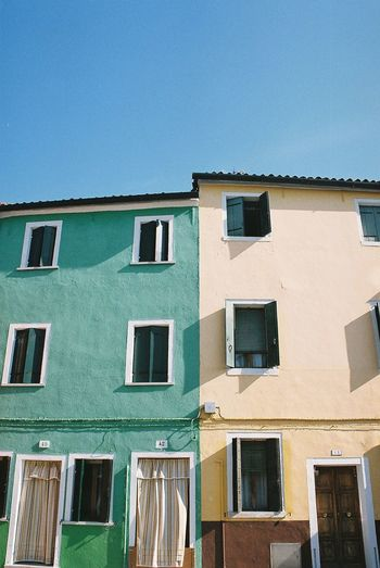 Burano Island Film Houses Analog Analog Photography Architecture Blue Building Building Exterior Burano Canonphotography City Clear Sky Colorful Eos500 Filmisnotdead Filmphotography Filmshooters House Italy Old Outdoors Residential District Sky Window