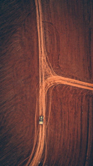 Aerial view of road by land