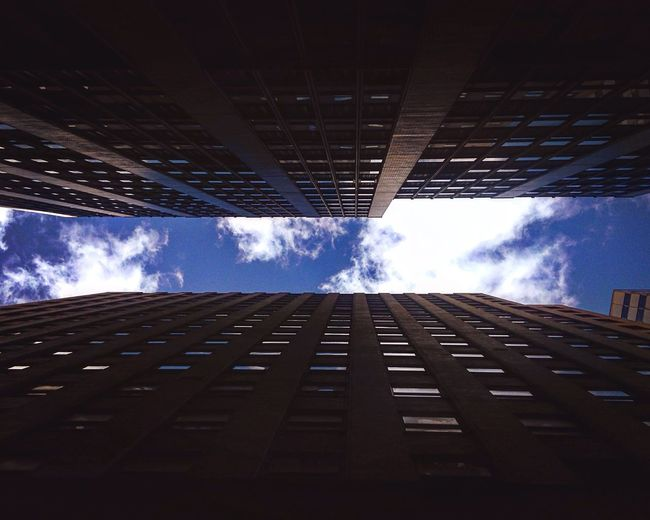 Friday! Wallstreet Downtown Nyc Look Up Future Skysthelimit Fly Travel Photography Travel The Changing City Sky Cityscape Geometry Clouds Skyscraper Architecture Lookingup From My Point Of View Vantage Point From Where I Stand