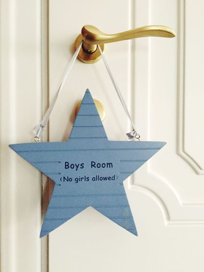 Close-Up Of Star Shaped Entrance Sign On Door Doorknob