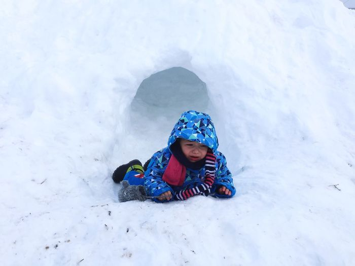 Fallen boy crying on snow