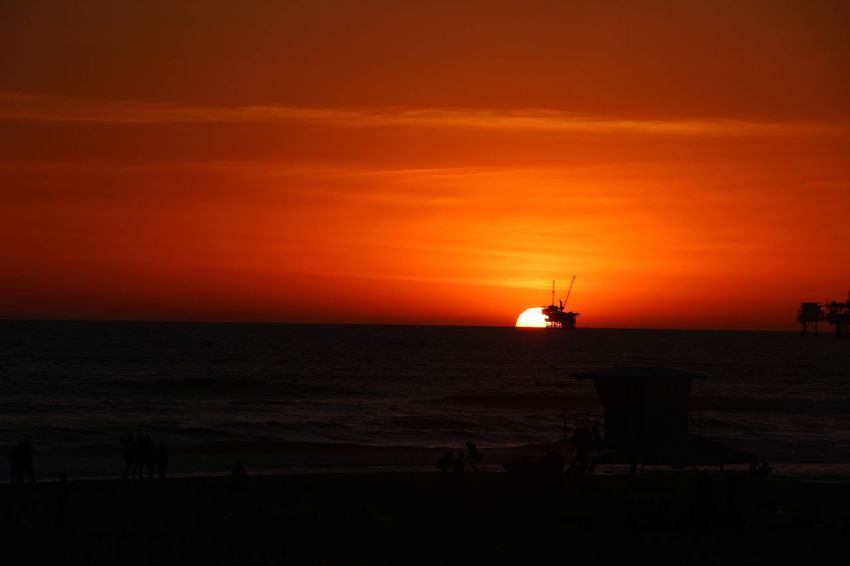 Sunset Sunset Silhouettes Oil Drilling Silhouette Huntington Beach California Travel Travel Destinations Vacation Nature Break The Mold