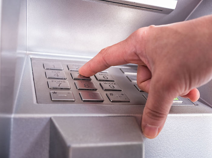 Hand inserting card into automatic teller machine to withdraw money Atm; Machine; Hand; Money; Code; Teller; Account; Pin; Bank; Withdraw; Debit; Card; Finance; Screen; Technology; Business; Banking; Customer; Credit; Automatic; Cash; Password; Closeup; Automated; Sign; Service; Keypad; Button; Man; Finger; Point; Push; F Business Computer Connection Convenience Finger Inserting Keyboard Keypad Technology Typing
