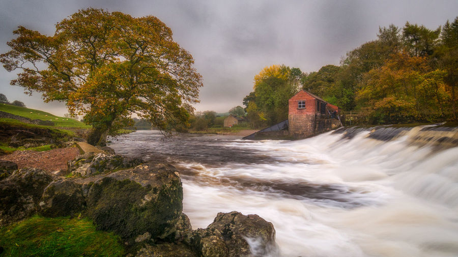 Going with the flow... Autumn Landscape_Collection LumixG80 Rugged Taking Photos Beauty In Nature Built Structure Colour England Landscape Long Exposure Malephotographerofthemonth Motion Nature No People Outdoors Power In Nature Scenics Sky Tree Water Waterfall