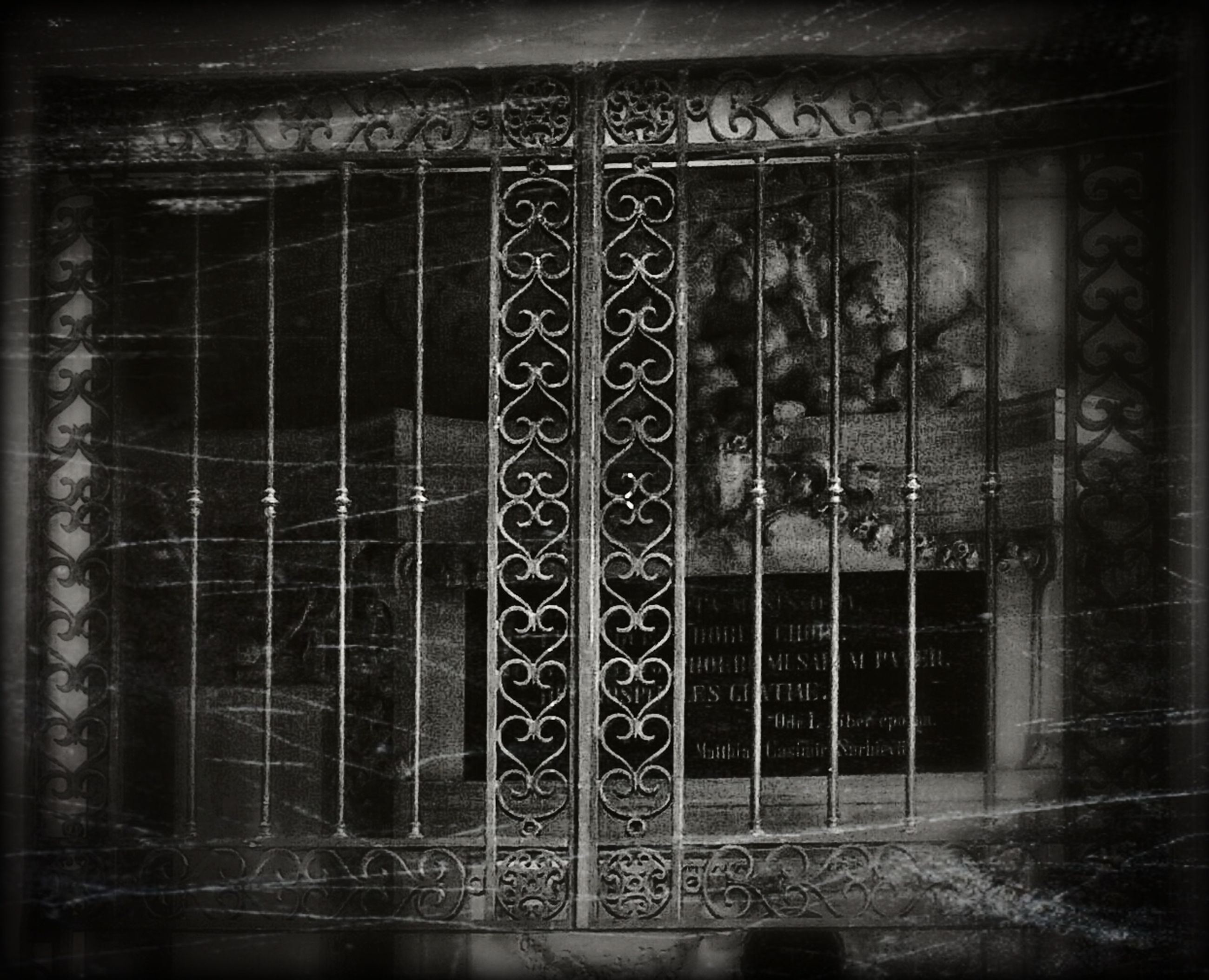 indoors, window, built structure, architecture, transfer print, closed, door, metal, metal grate, old, auto post production filter, entrance, house, safety, protection, gate, abandoned, glass - material, pattern, wall - building feature