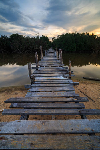 The old wood bridge across a river with sunset scenery at Marang, Terengganu Sunset_collection Wood Beauty In Nature Bridge Cloud - Sky Day Jetty Landscape Nature No People Old Outdoors River Scenics Sky Sunrise Sunset The Way Forward Tranquil Scene Tranquility Tree Vintage Water Wood - Material Wood Paneling