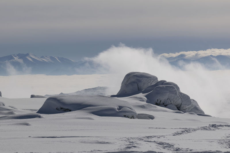 Top Of The Mountains Above The Clouds Snow Covered Cloud - Sky Mountain Range Landscape Nature Rock - Object Cold Temperature Snow Rock Formation Geology Scenics Mountain