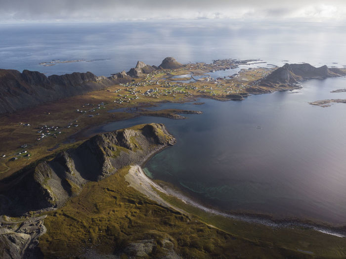 Aerial view of rocks on beach against sky in norway. a small island in the lofoten archipelago