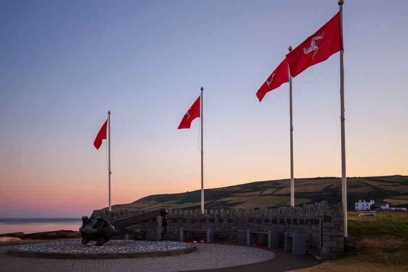 Triskelion Port St Mary National Flag Three Legs Of Man Isle Of Man Flag Sky Patriotism Nature Water No People Land Scenics - Nature Sea Beauty In Nature Tranquility Pole Red Tranquil Scene Outdoors Environment HUAWEI Photo Award: After Dark