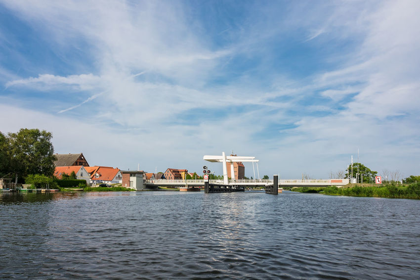 View to Loitz in Germany. City Holiday Mecklenburg-Vorpommern Peene Architecture Beauty In Nature Bridge Building Exterior Built Structure Cloud - Sky Day Loitz Nature No People Outdoors River Sky Tourism Town Travel Destinations Vacation Water Waterfront