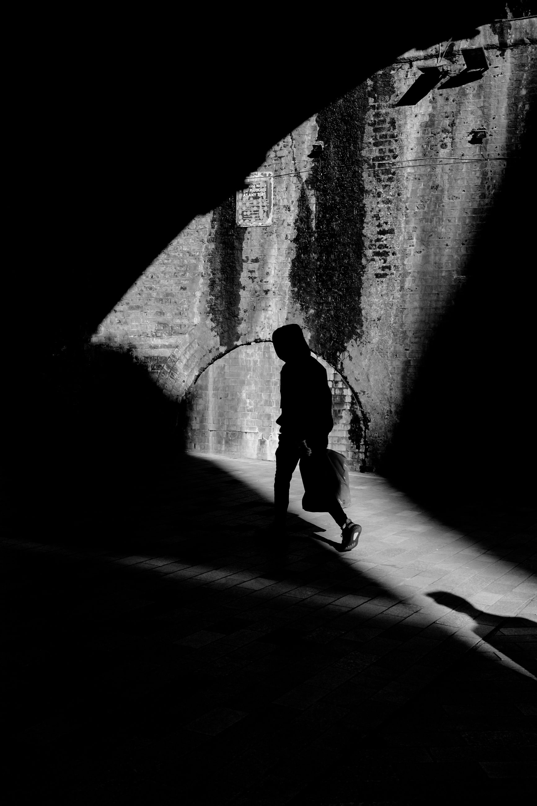 full length, real people, one person, walking, architecture, nature, day, lifestyles, shadow, the way forward, men, direction, rear view, sunlight, silhouette, tunnel, transportation, leisure activity, outdoors, light at the end of the tunnel