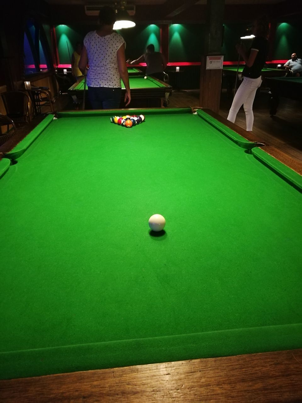 pool table, pool ball, pool - cue sport, indoors, snooker, sport, pool cue, green color, table, ball, leisure games, leisure activity, cue ball, playing, real people, competition, snooker and pool, one person, snooker ball, pool hall, day, adult, people