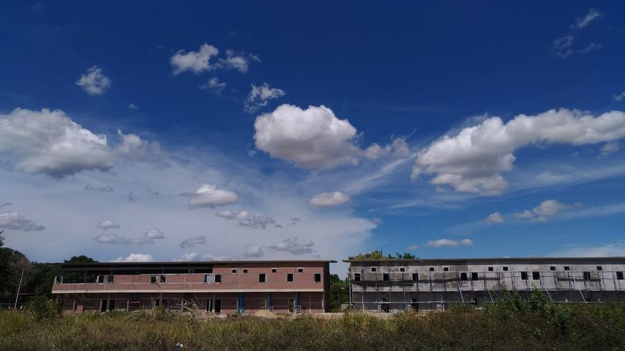 Houses and buildings against blue sky